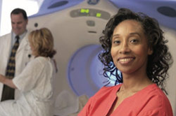 Woman standing in front of an MRI machine