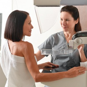 Technician preparing the Mammogram machine for patient